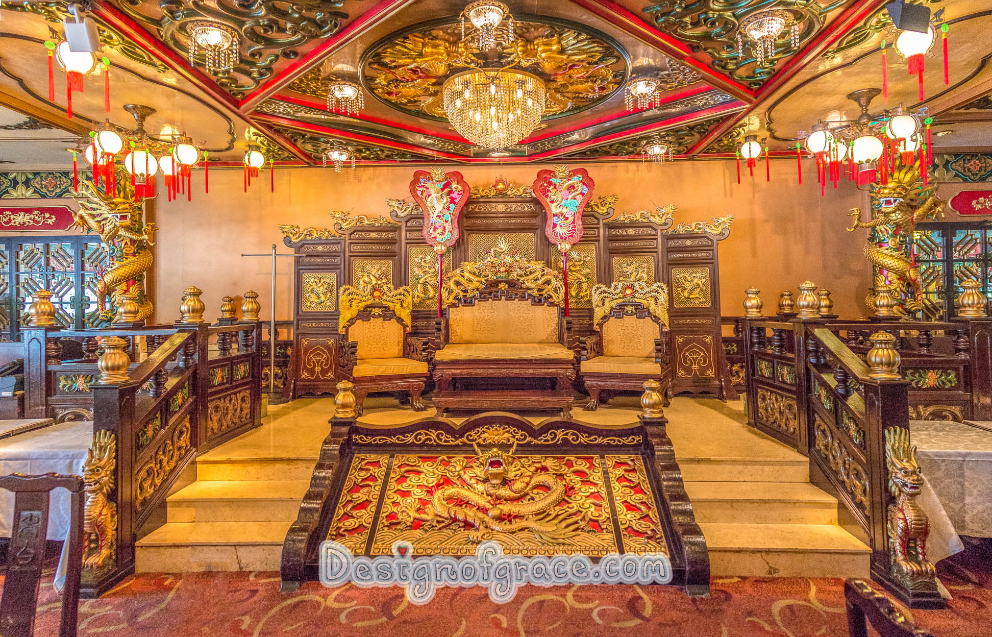 A Very elaborate gold and red throne benches at Jumbo Kingdom in Hong Kong
