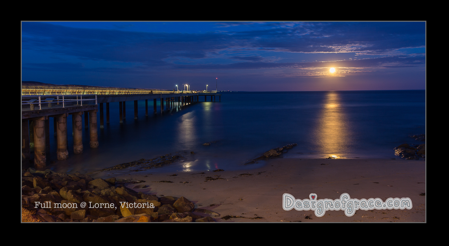 Beautiful full moon rising over the ocean with the Lorne jetty.