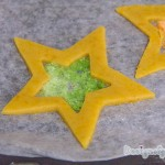 Close up of the green pre-baked stained glass cookie.