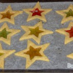 A tray of baked stained glass cookie.