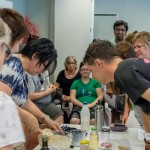 Elizabeth the presenter mixing the ingredients in the mixing bowl with workshop participants watching