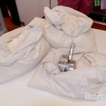 three sacks of flour with measuring cups in the bottom right bag