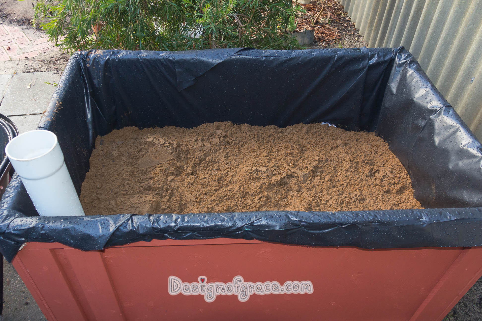 Ran out of pea gravel so decided to top the rest up with sand.. We did about 200 mm for the reservoir layer