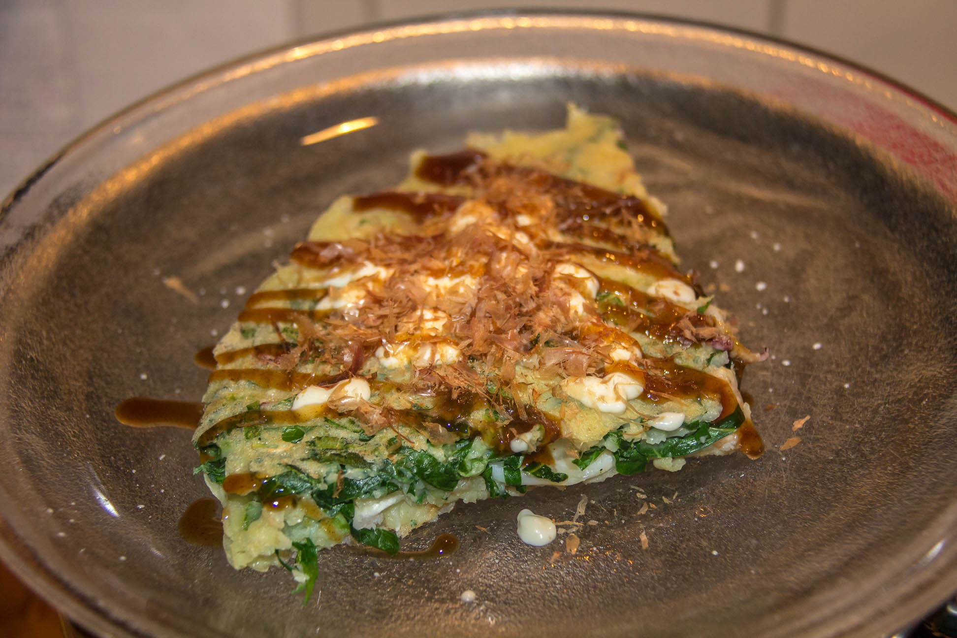 05/07/15 A slice of the finished dish with Japanese mayo and Okonomiyaki sauce and fish flakes