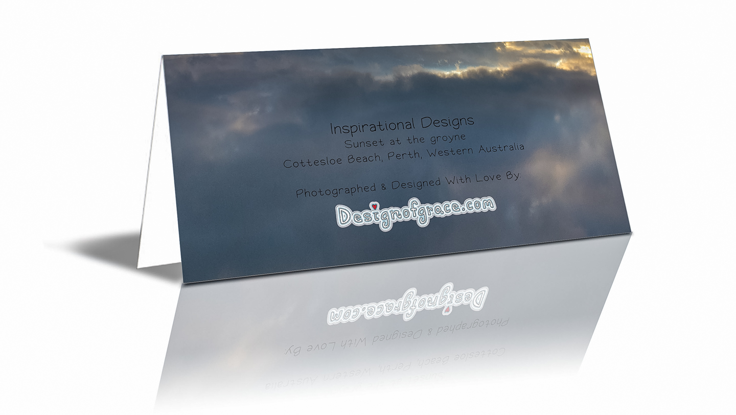 """The back of the card with more details such as: """"Sunset at the groyne Cottesloe Beach, Perth, Western Australia"""""""