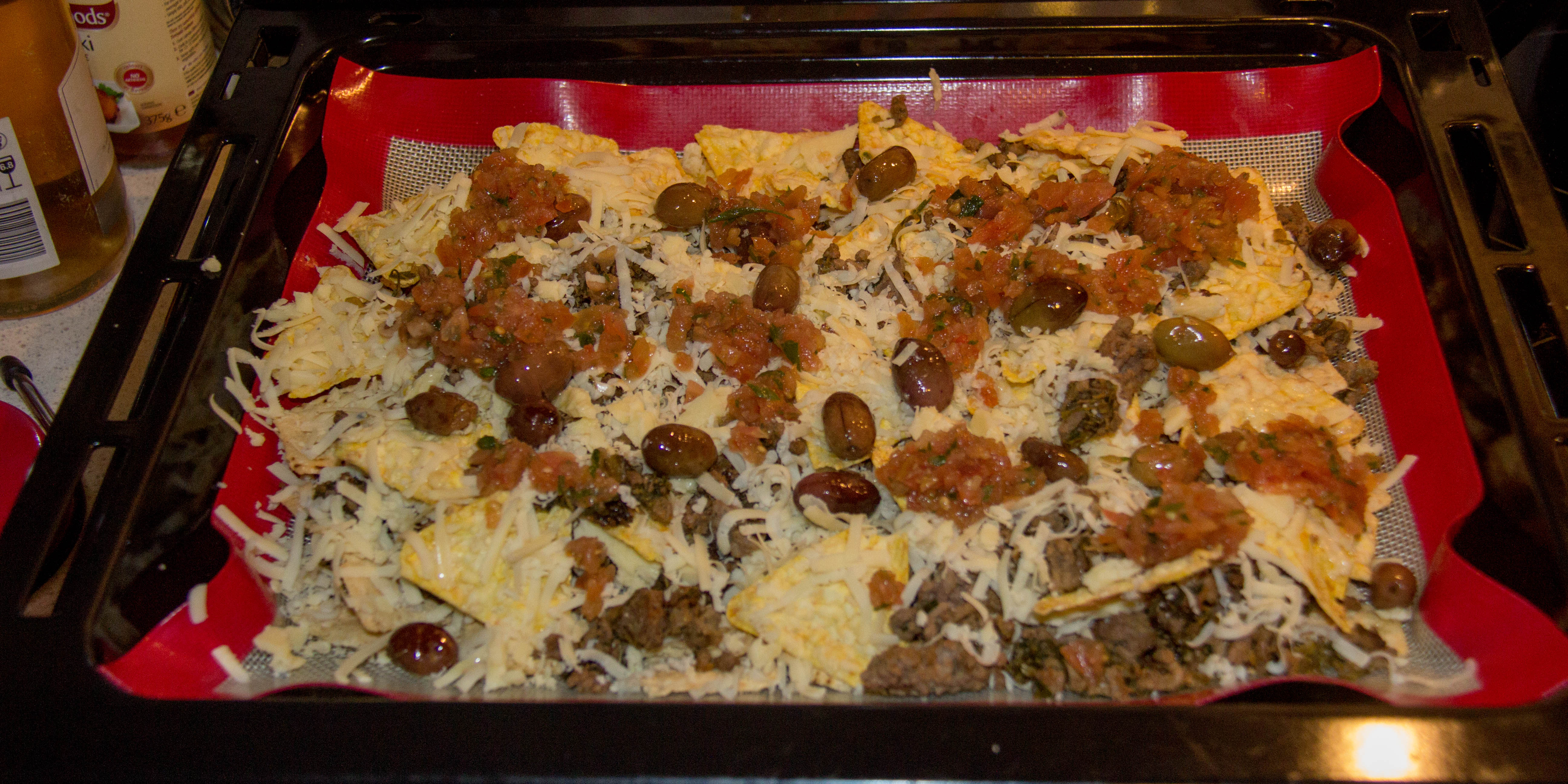Nachos using home made olives from our tree and left over mince with our store bought re-grown cabbage