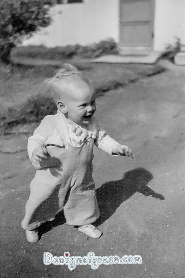 old black and white photo of a baby walking