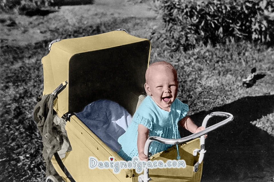 old black and white photo of a baby in the pram coloured by me