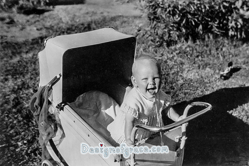old black and white photo of a baby in the pram