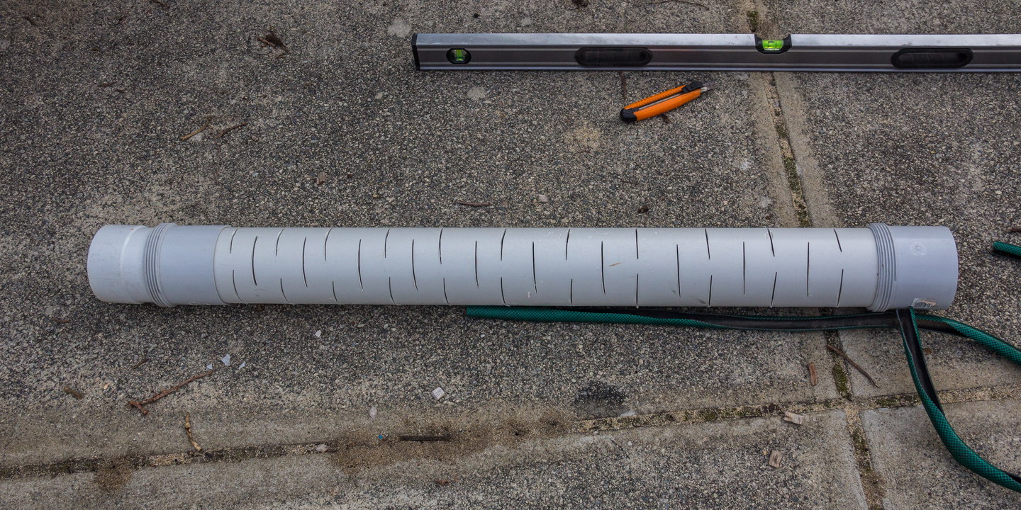 Angle grinded holes in the PVC pipe to allow water to allow through.