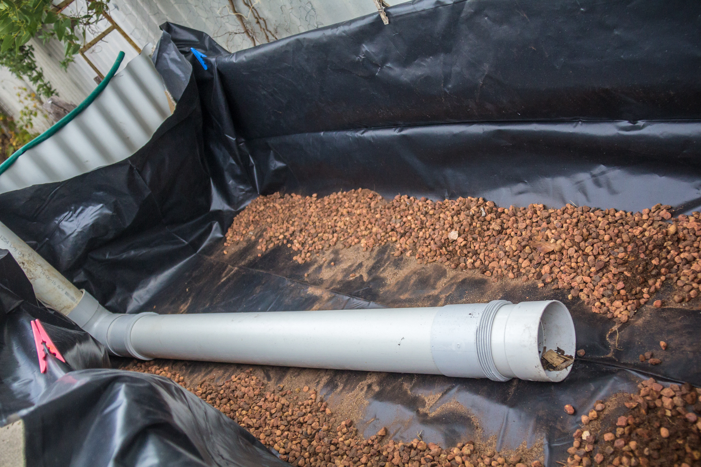 pea gravel and pipe in place. fill the box 1/2 way up the height of the pipe.
