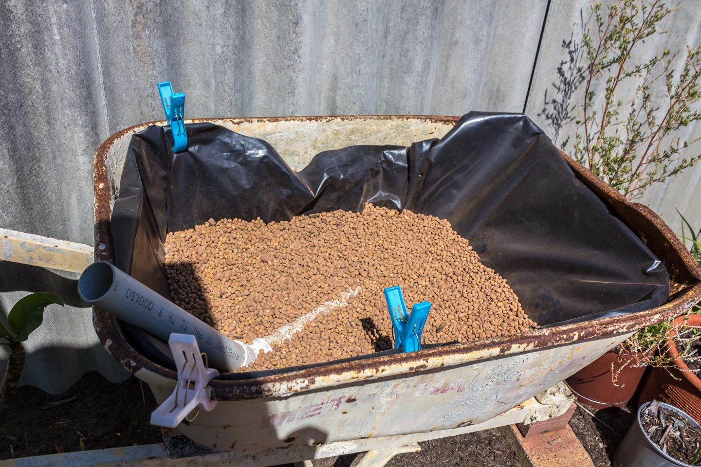 Fill with pea gravel slightly covering the pvc pipe