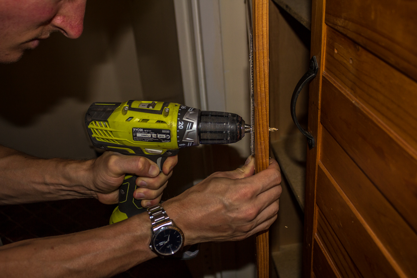 30/12/15 Day 5 [Only time we had available] Hubby drilling a hole in the door using the template