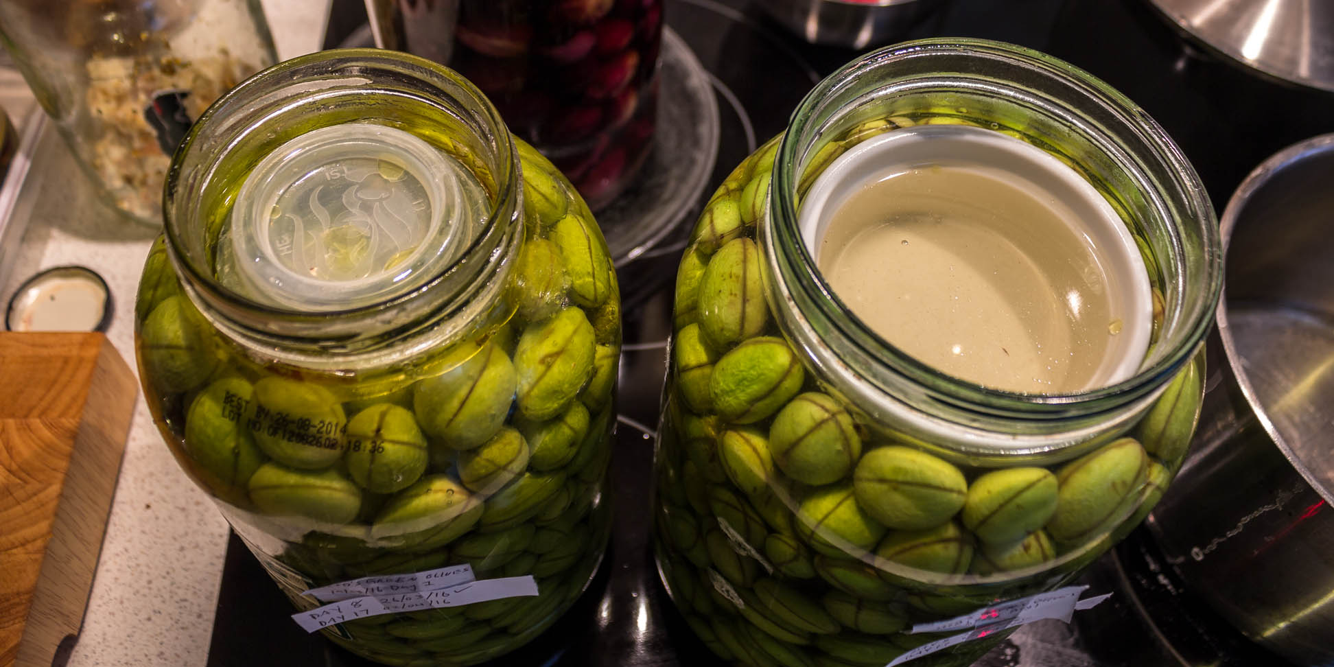 Olives in the jar with new brine solution.