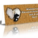 """Two lambs sleeping on each other in a heart shape design saying """"Wishing You A Blessed Christmas and A Lovely New Year!"""""""