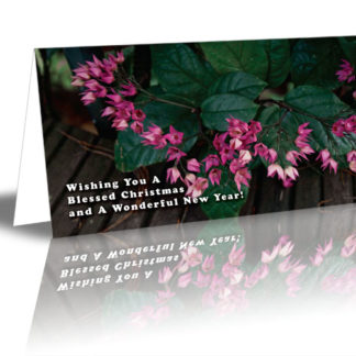 "Pink Flowers design saying ""Wishing You A Blessed Christmas and A Wonderful New Year!"""