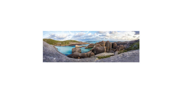 Beautiful turquoise waters with rocks which looks like elephants. With a rainbow in the background