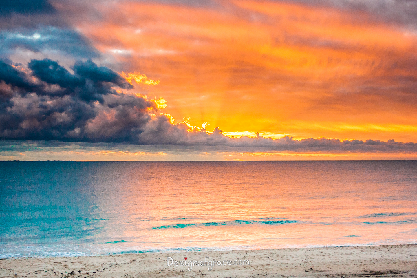 Pink And Orange Sunset With A Dark Blue Cloud On The Left Ocean Reflecting