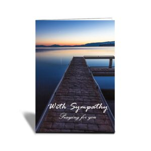 Still waters at Flathead Lake Jetty at sunset with orange and blue colours vertical card with text With Sympathy praying for you