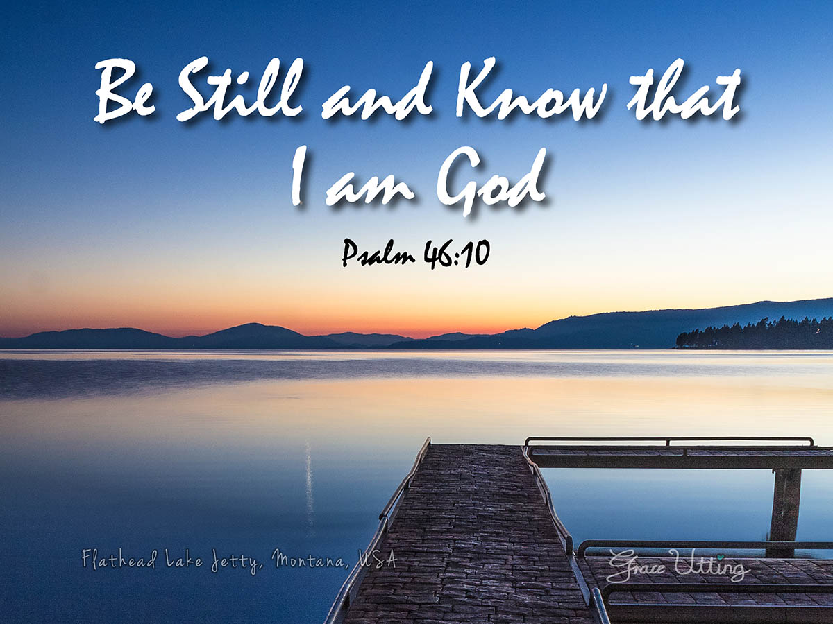 "Still waters at Flathead Lake Jetty at sunset, Montana, USA  with the text "" Be Still and Know that I am God, Psalm 46:10″"