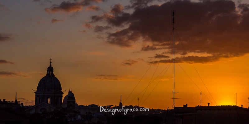 orange Sunset silhouette of st peters from the top of Spanish steps