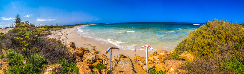 Hopetoun Beach Panorama with clear blue skies and turquoise waters with yellow rocks on the left and right with steps leading down to the beach , Ravensthorpe, Western Australia