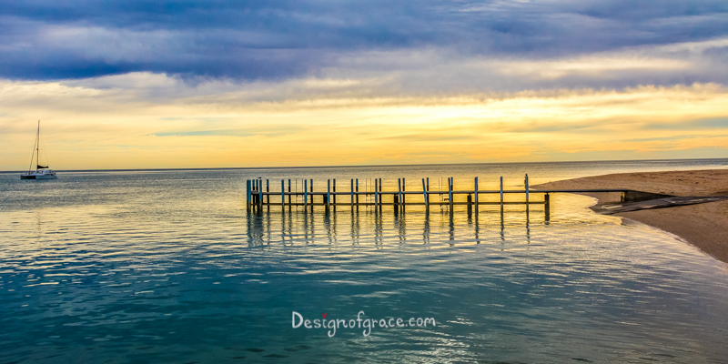 Monkey Mia Jetty Monkey Mia Jetty Sunrise with orange and blue skies with dark blue water, Shark Bay, Western Australia