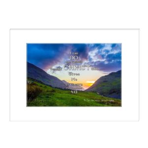 """Snowdon Valley Sunset with purple and orange hues contrasted with the green grass on the bottom with 2 mountain on either side with the sun in the setted in the middle, Wales, UK with the bible inspired words """"I can do all things through Christ who gives me strength .Philippians 4:13"""""""