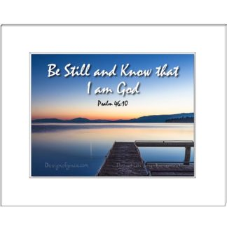 "19 Still waters at Flathead Lake Jetty at sunset with orange and blue colours , Montana, USA  with the text "" Be Still and Know that I am God, Psalm 46:10"""