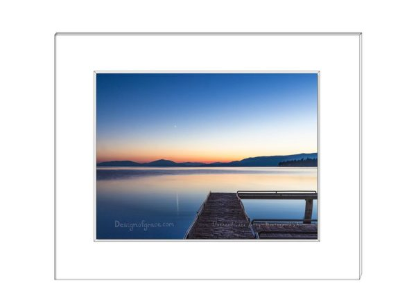 19 Still waters at Flathead Lake Jetty at sunset with orange and blue colours