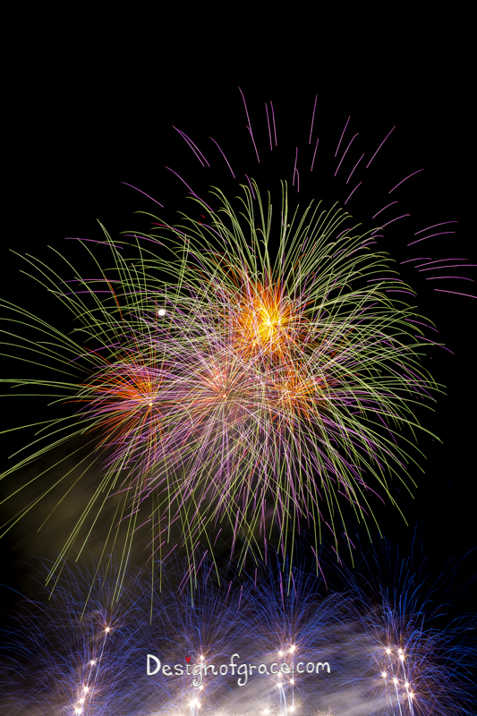 blue, yellow, orange and purple fireworks