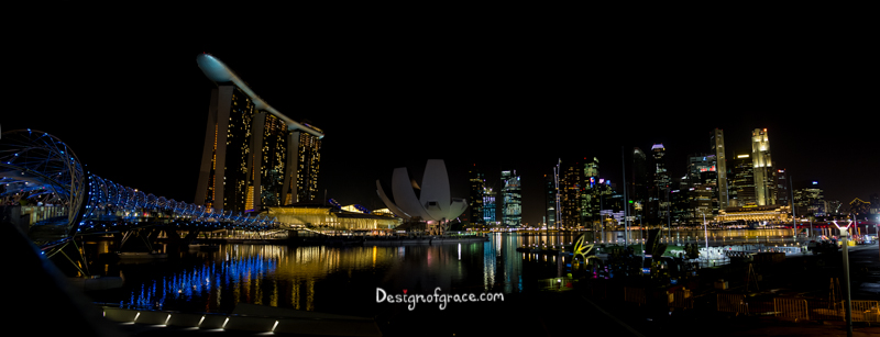 Marina Bay Sands Night Panorama with ligths reflection in the water, Singapore
